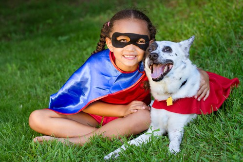 Cute Child Image of Super Hero Girl and Dog