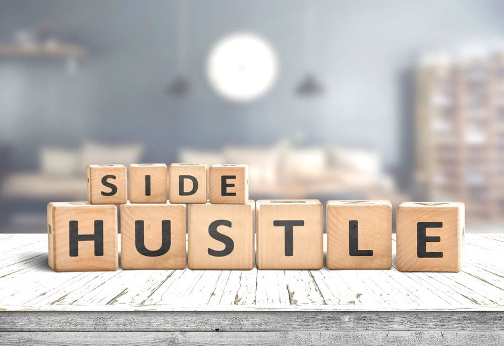 Side Hustle speled out in building blocks on desk