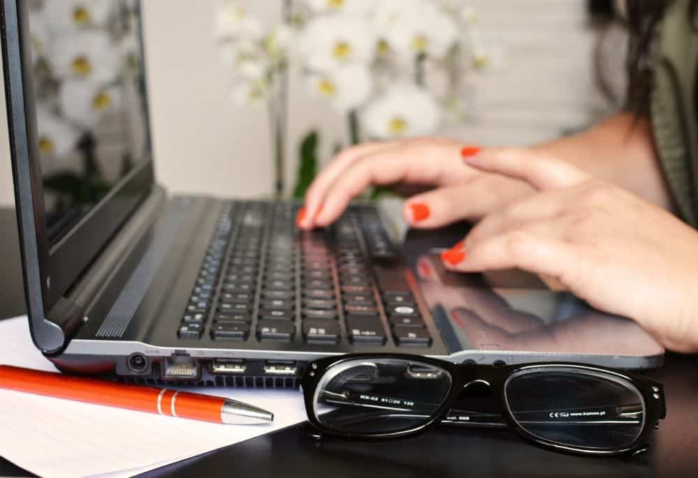 Woman on Laptop Getting Paid to Write Articles Online