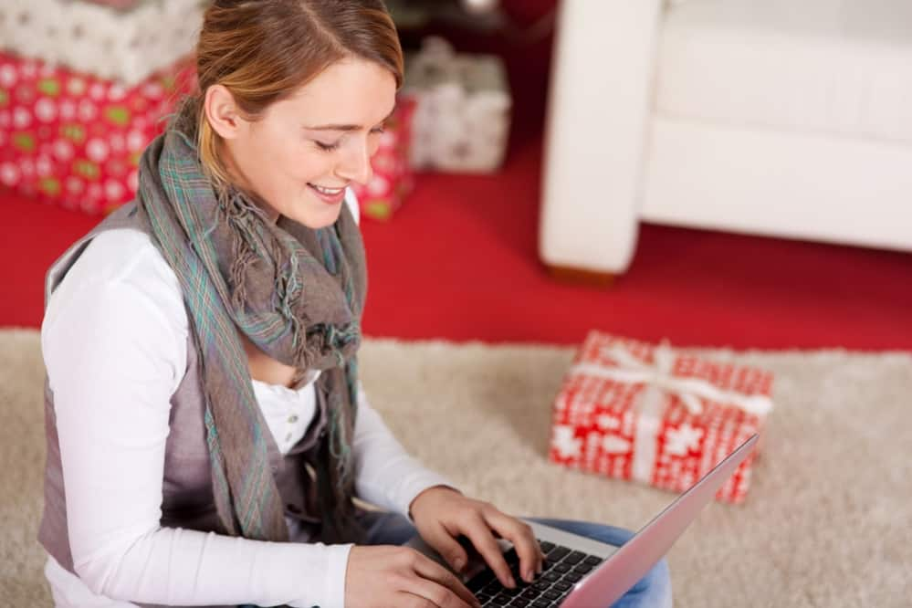 Woman typing on laptop during christmas holiday