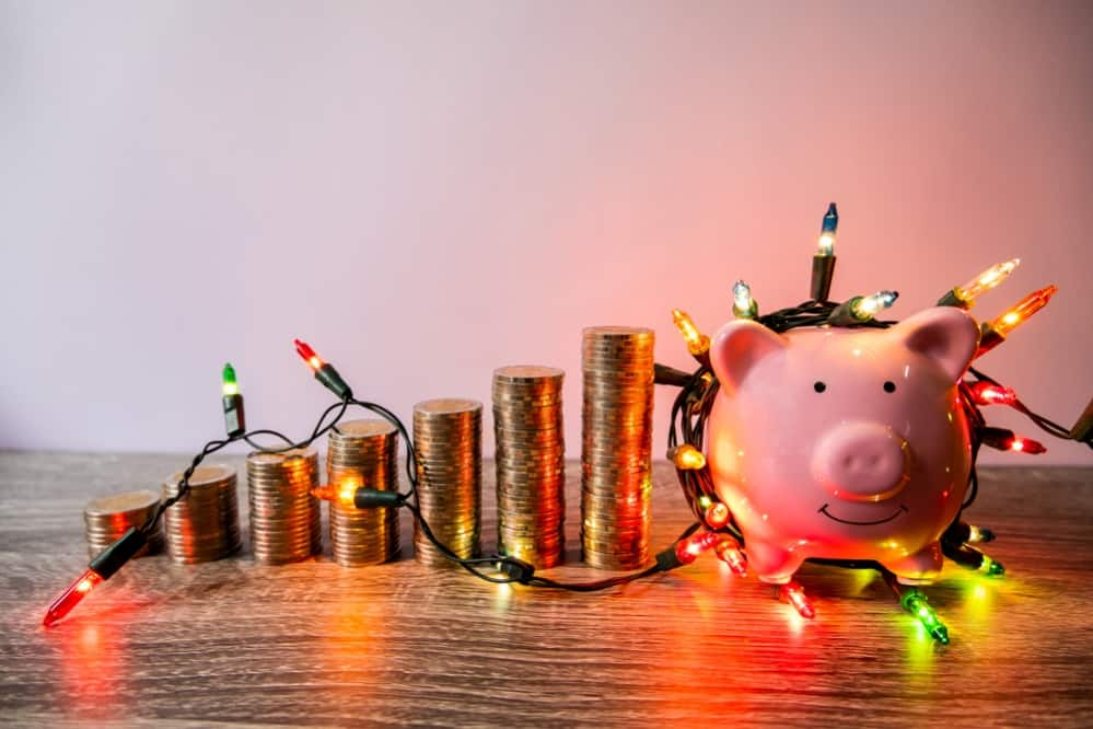 Saving Money in Piggy Bank for holiday season
