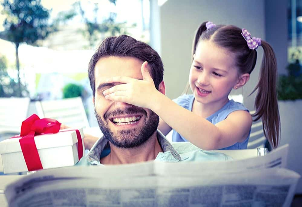 work at home Dad getting gift from daughter