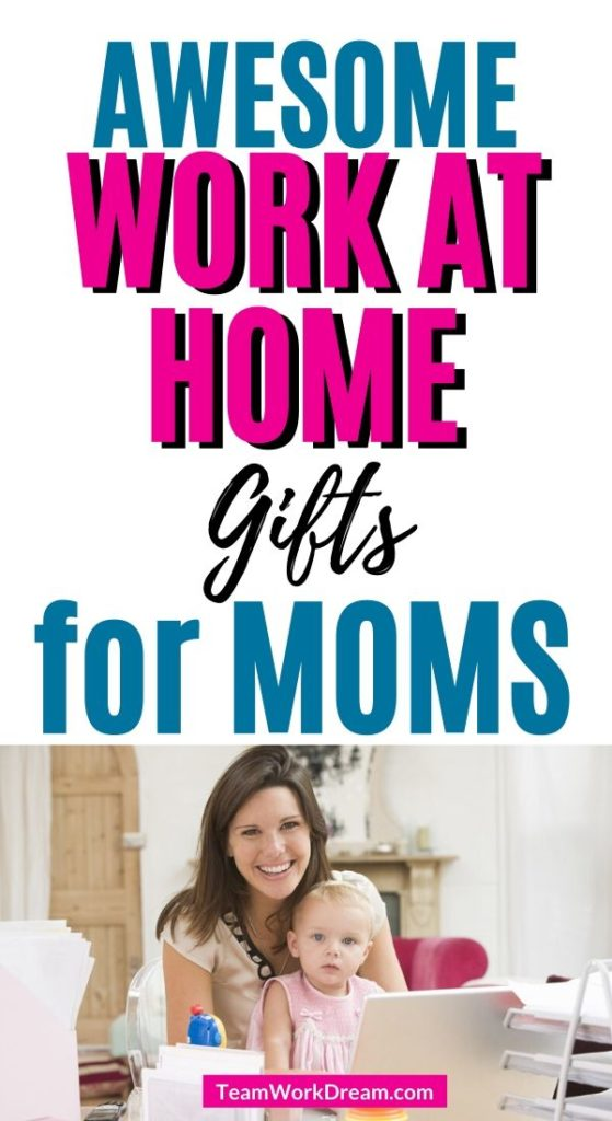 Woman working in home office with baby on lap working at home.