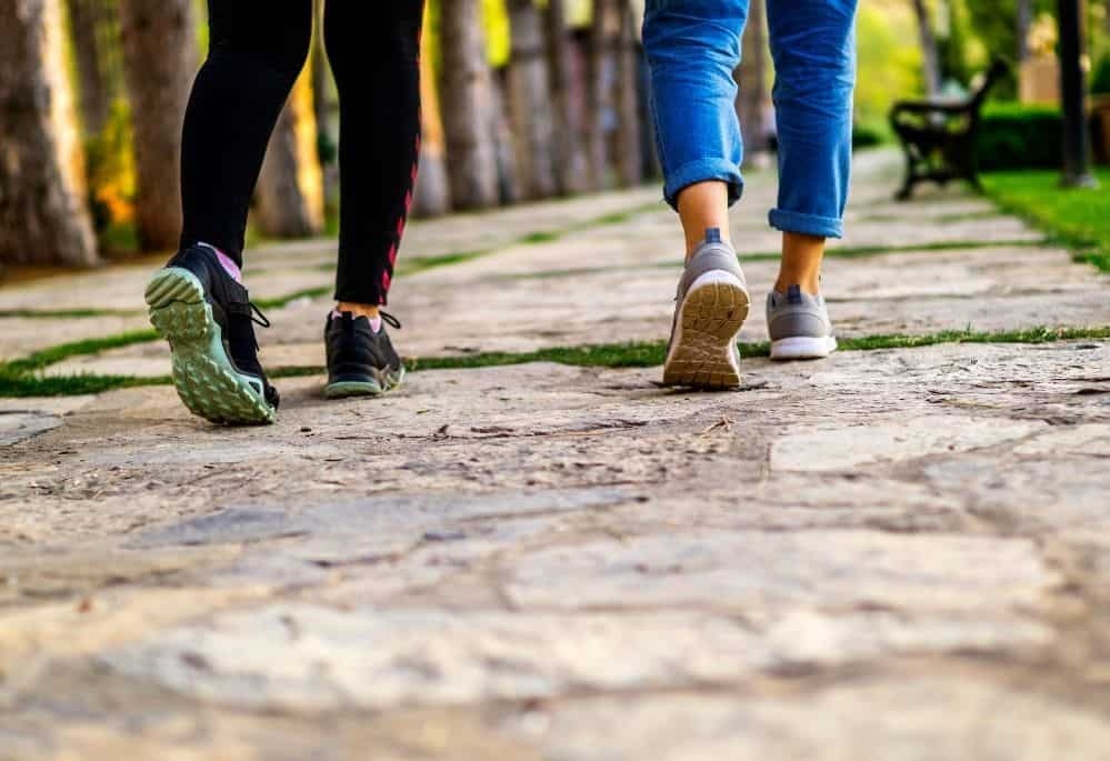 Two women using apps that pay you to walk