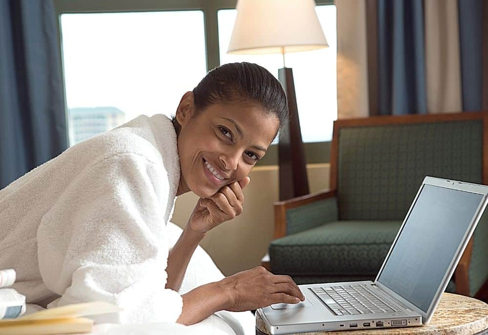 Woman on Laptop doing her hotel mystery shopper job